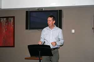 A speaker presenting a speech at the lecturn